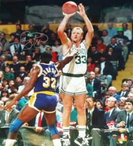 larry-bird-boston-celtics-shooting-over-magic-autographed-photograph-3339900